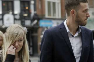 The parents of critically ill baby Charlie Gard, Connie Yates and Chris Gard arrive at the High Court in London, Monday, July 24, 2017