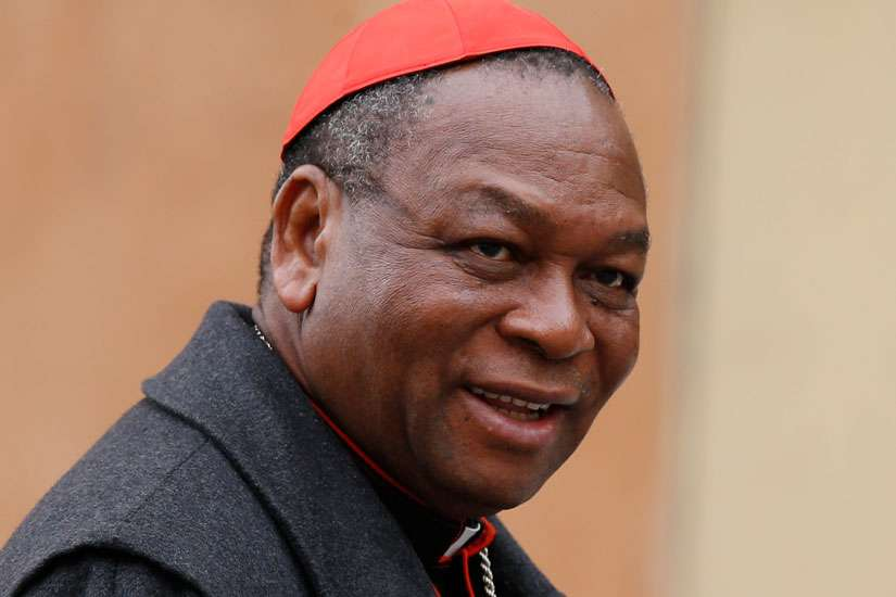 Cardinal John Olorunfemi Onaiyekan of Abuja, Nigeria, is pictured in a 2013 photo at the Vatican.Two bishops from southern Nigeria condemned an attack on a vehicle carrying Cardinal Onaiyekan and appealed to the government to tackle the issue of growing attacks in Edo state.
