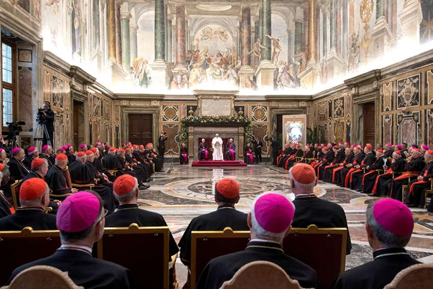 Pope Francis speaks during his annual pre-Christmas meeting with top officials of the Roman Curia and Vatican City State and with cardinals living in Rome in the Clementine Hall Dec. 21 at the Vatican.