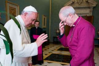 Pope Francis blesses Anglican Archbishop Justin Welby of Canterbury, spiritual leader of the Anglican Communion, during a private meeting at the Vatican June 16, 2014