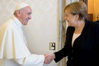 Pope Francis shakes hands with German Chancellor Angela Merkel at the Vatican June 17.