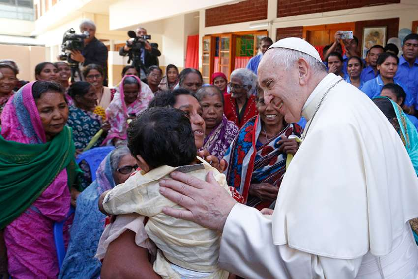 Pope Francis greets people as he visits the Mother Teresa House in the Tejgaon neighborhood in Dhaka, Bangladesh, Dec. 2.