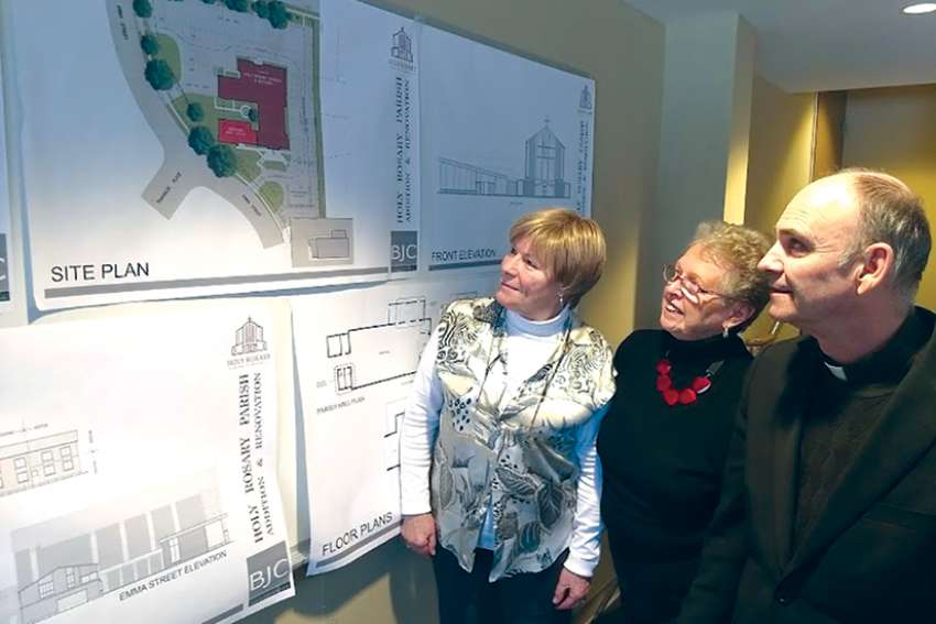Architects have drawn up plans for building additions and improvements at Holy Rosary Parish in Guelph. Here, from left, are parishioners Maria Gazzola and Barbara Smith and Fr. Vernon Boyd, S.J., pastor of Holy Rosary.