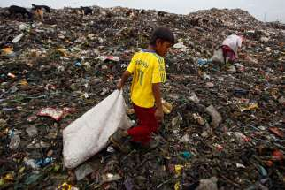 A boy collects recyclable materials at a dumpsite in Medan, Indonesia, Nov. 30. The U.N. climate change conference, known as the COP21 summit, runs from Nov. 30-Dec. 11 near Paris.