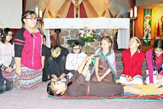 Young people from Our Lady of Seven Sorrows Parish in Maskwacis, Alberta, perform a play based on the life of St. Kateri Tekakwitha. It was part of a July 14 Mass and celebration honoring North America's first indigenous saint.