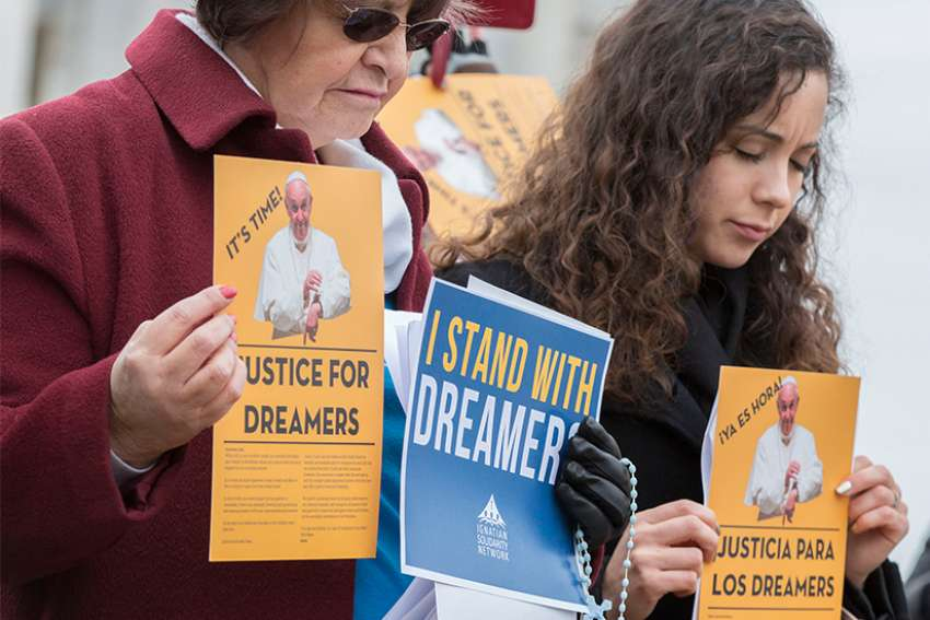 At right, Maria Jose, a recipient of the Deferred Action for Childhood Arrivals program, joins participants at a Feb. 6 prayer service outside the U.S. Capitol to pray for Dreamers and for legislators who are working to pass immigration legislation.