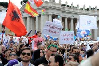 People gather for a May 4 pro-life demonstration in St. Peter's Square at the Vatican. According to organizers, more than 50 pro-life groups active in some 20 countries took part in the march.