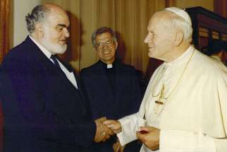 Romeo Maoine meets Pope John Paul II. Mr. Maoine was the first director of Development and Peace. He died May 12.