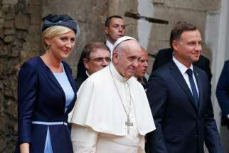 Pope Francis, Polish President Andrzej Duda and first lady Agata Kornhauser-Duda arrive for a meeting with government authorities and the diplomatic corps in the courtyard of Wawel Royal Castle in Krakow, Poland, July 27.