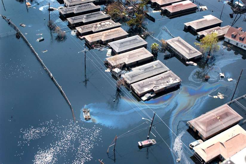 Homes are seen surrounded by floodwaters and oil slicks in St. Bernard Parish, south of New Orleans, after Hurricane Katrina swept through the area in 2005. A decade after Hurricane Katrina, the city continues to rebuild.