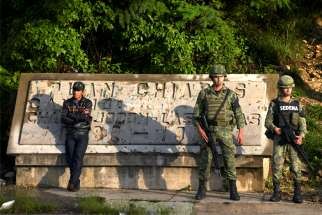 Members of the National Guard keep watch at a checkpoint in Mexico's Chiapas state June 16, 2019. A catechist instructor was shot dead June 15 at Immaculate Conception chapel in Acacoyagua, about 75 miles from the border with Guatemala.