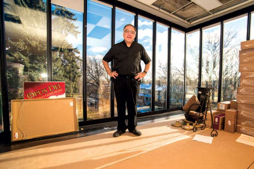 Fr. Thomas Rosica, CEO of the Salt and Light Media Foundation, stands in the new headquarters of the Catholic broadcaster in midtown Toronto. Salt + Light has almost tripled its space with the move.