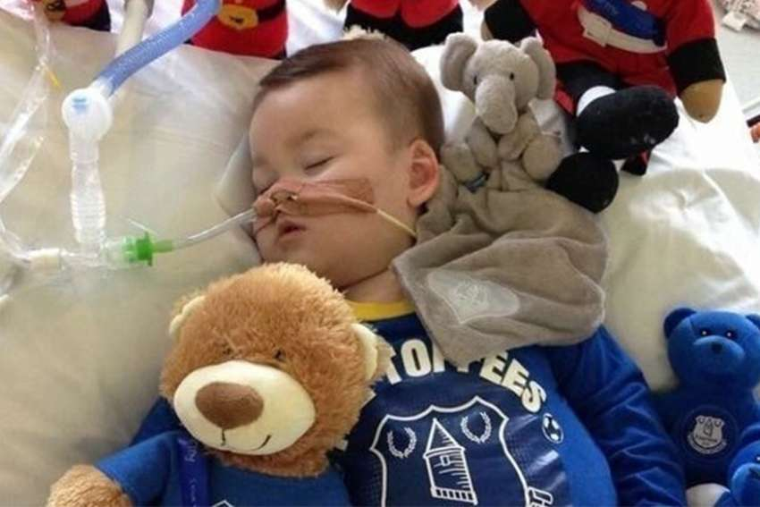"Alfie Evans picture lying in his hospital bed at Alder Hey Hospital. He has been hospitalized continuously since Dec. 2016, suffering from chronic seizures of an undiagnosed disorder. Evans is in a ""semi-vegetative state"" and on life support at Alder Hey Children's Hospital in Liverpool, where doctors have said further efforts are futile and went to court to argue that continuing treatment, as his parents wish, is not in Evans' best interest."