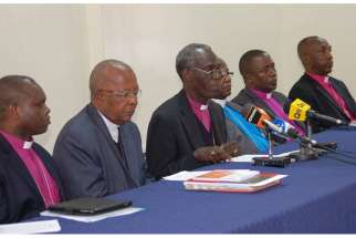 Kenyan church leaders, including Roman Catholic Cardinal John Njue, second left, and Anglican Archbishop Eliud Wabukala, third left, address a news conference at the All Saints Cathedral in Nairobi.