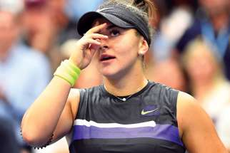 Bianca Andreescu makes the sign of the cross after beating Serena Williams in the final of the U.S. Open tennis championship Sept. 7 at Arthur Ashe Stadium in Flushing, N.Y. The 19-year-old Andreescu became the first Canadian ever to win a Grand Slam singles title.