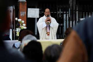 Father Alejandro Solalinde, a human rights activist, celebrates an outdoor Mass Jan. 11 in Mexico City. Presidential front-runner Andres Manuel Lopez Obrador of the National Regeneration Movement said he will appoint the priest human rights director if elected president.