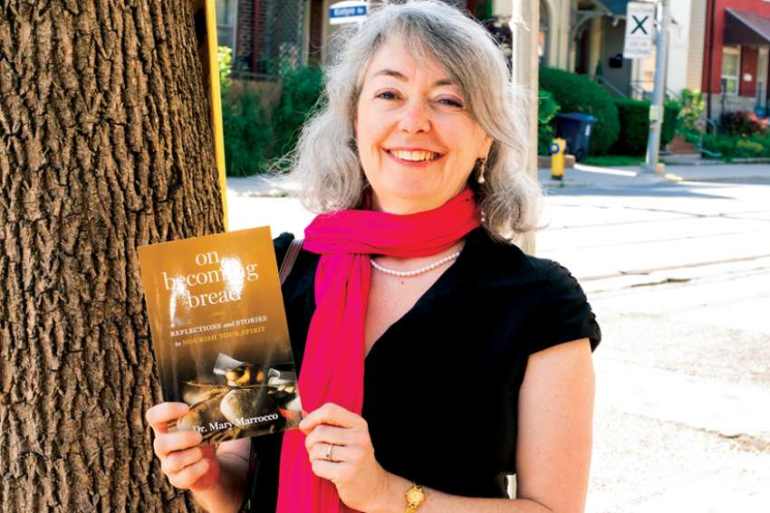 Mary Marrocco poses with her book, 'On Becoming Bread.'