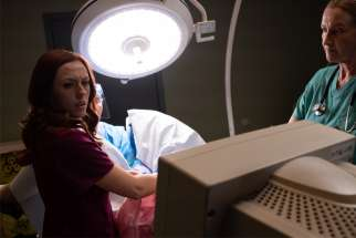 "Abby Johnson, portrayed by Ashley Bratcher, reacts to what she is seeing on the ultrasound screen while assisting with an abortion in this clip from the movie ""Unplanned."""