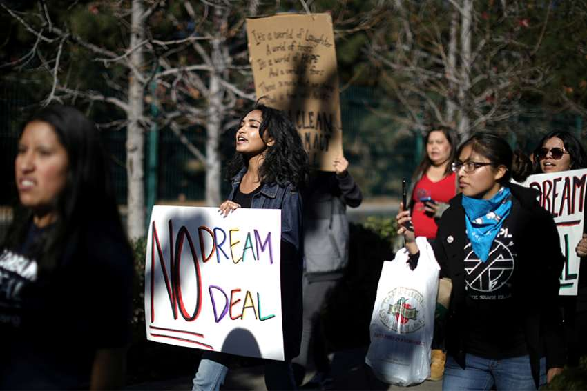 Recipients and supporters of the Deferred Action for Childhood Arrivals program protest Jan. 22 outside Disneyland in Anaheim, Calif.