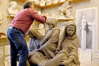 Lawrence Voaides works on the Pietà that will be placed above the Loretto sisters' crypt.