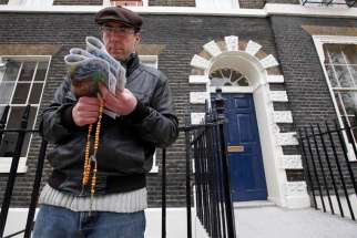 A pro-life activist holds a rosary outside an abortion clinic in 2012 in London. Auxiliary Bishop John Sherrington of Westminster praised a decision by the British government not to impose exclusion zones around abortion clinics throughout the country.