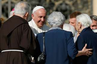 Pope Francis greets people during an encounter with the elderly in St. Peter's Square at the Vatican Sept. 28.