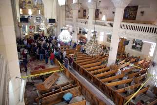 Security personnel investigate the scene of a bomb explosion on April 9 inside the Orthodox Church of St. George in Tanta, Egypt. That same day an explosion went off outside the Cathedral of St. Mark in Alexandria where Coptic Orthodox Pope Tawadros II was presiding over the Palm Sunday service.