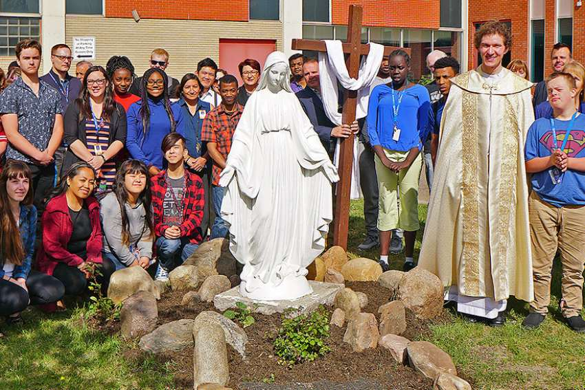 Students and staff attend the blessing of statues of Mary and Joseph, which were relocated to St. Joseph High School in Edmonton after their last home, a monastery, was closed.