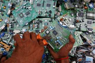 "A man in Karachi, Pakistan, retrieves circuit boards from discarded computer monitors Aug. 16, 2017. An economic system lacking any ethics leads to a ""throwaway"" culture of consumption and waste, Pope Francis said in a speech addressed to members of the Council for Inclusive Capitalism during an audience at the Vatican Nov. 11."