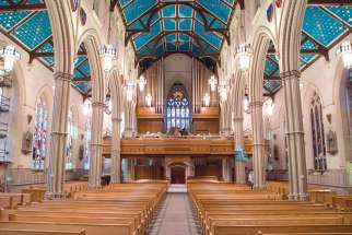 The view from the altar at St. Michael's Cathedral looking back to the new choir loft, organ and restored stained-glass window.