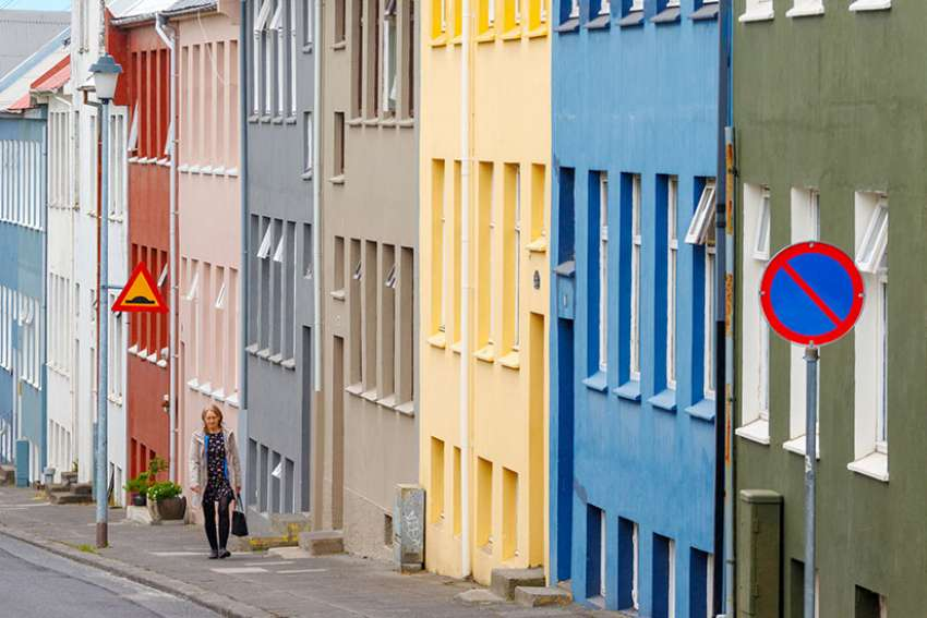"A woman walks along a street in Reykjavik, Iceland, June 15. The country is on its way to ""eliminate"" people with Down syndrome, a report from CBS News explained, causing uproar in the pro-life community over the high numbers of abortions following prenatal diagnosis of Down syndrome."