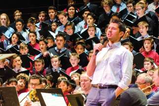 Choir school alumnus Matt Dusk sings with St. Michael's Choir School as they rehearse for their annual Christmas concert at Massey Hall.