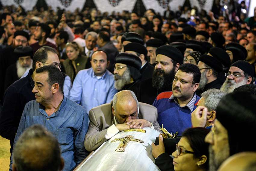 Mourners attend the April 10 funeral for victims of a bomb attack the previous day at the Orthodox Church of St. George in Tanta, Egypt. Also April 9, an explosion went off outside the Cathedral of St. Mark in Alexandria where Coptic Orthodox Pope Tawadros II was presiding over the Palm Sunday service.
