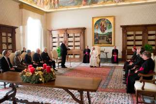 Pope Francis attends a special audience with members of the German Evangelical-Lutheran Church at the Vatican Dec. 18.