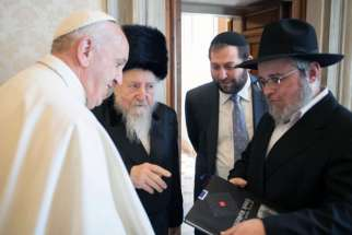 Pope Francis meets with Rabbi Edgar Gluck, chief rabbi of Galicia, centre left, during a private audience at the Vatican on May 8, 2017.