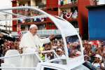 Pope Francis waves from his popemobile as he arrives for World Youth Day in Panama City Jan. 23, 2019.