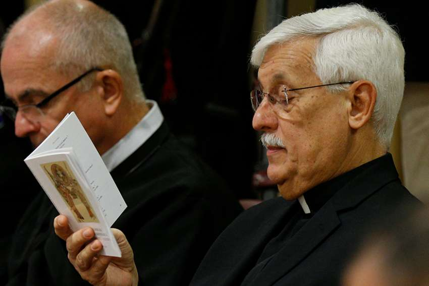 Father Arturo Sosa Abascal, superior general of the Society of Jesus, prays at the start of a session of the Synod of Bishops on young people, the faith and vocational discernment at the Vatican Oct. 11.