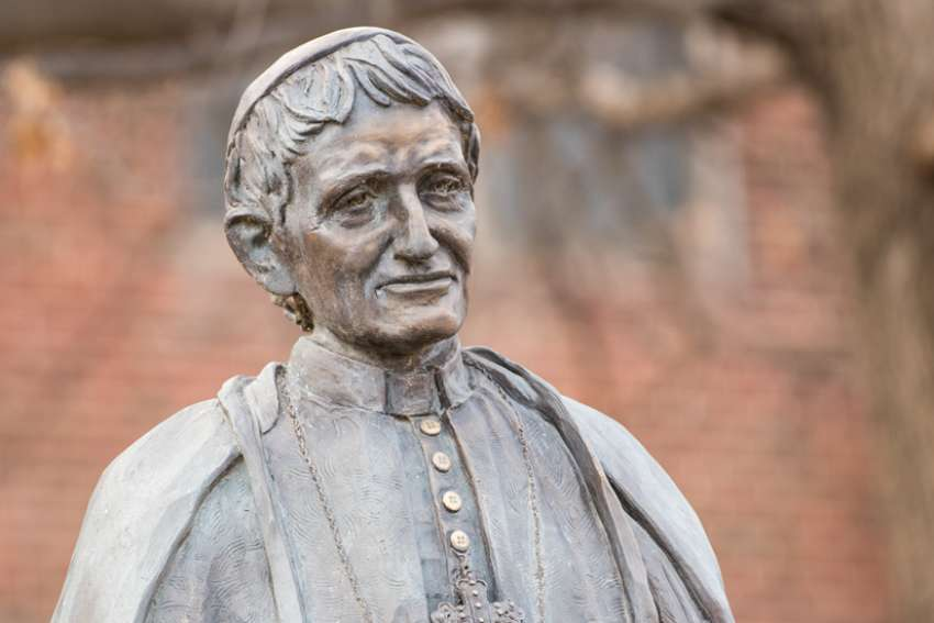 A statue of St. John Henry Newman stands on the campus of Newman University in Wichita, Kan., just one of many colleges across North America that has incorporated his name and  work into their institutions.