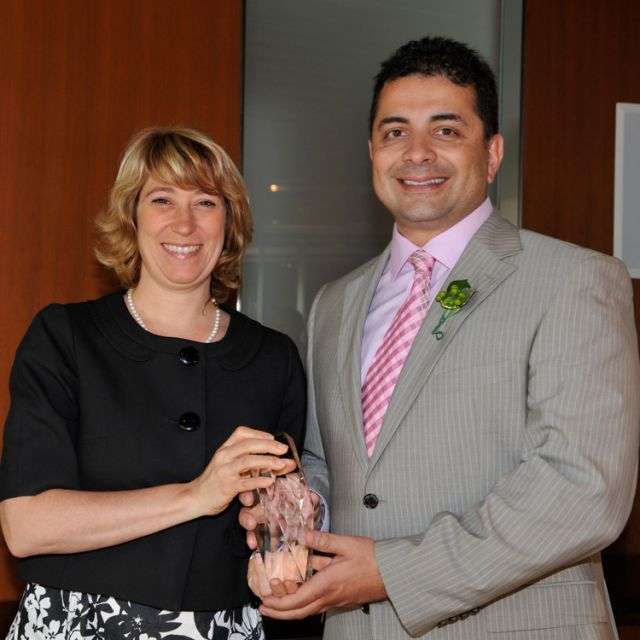Education Minister Laurel Broten presents the Premier's Award for Excellence in Leadership to principal Mark Cassar.
