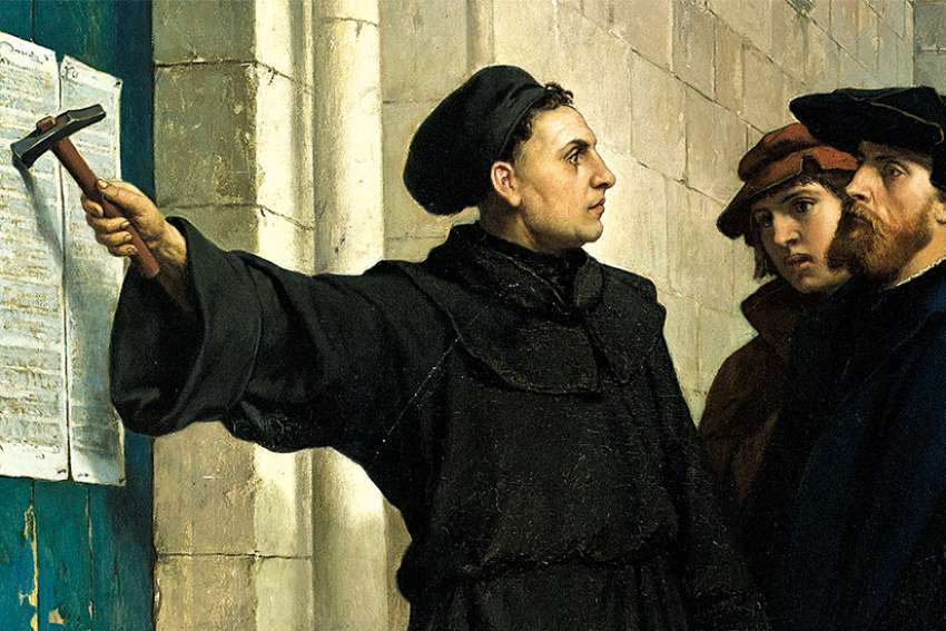 Martin Luther hammers his 95 theses on a church door, as depicted by Belgian painter Ferdinand Eauwels, an act that prompted the Reformation 500 years ago.