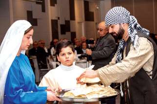 In the traditional dress of Iraq's indigenous Chaldeans, Anta Alantwan, Antonues Polo and Suhel Bawood distributed bread and salt to begin the 2018 Christians in the Middle East Benefit Dinner, this year focussing on Iraq.