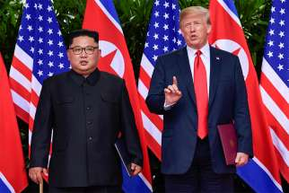 U.S. President Donald Trump makes a statement before saying goodbye to North Korea leader Kim Jong Un after their meeting at the Capella Hotel on Sentosa island in Singapore June 12. Signing a joint statement, President Trump agreed to provide security guarantees to North Korea and Chairman Kim reaffirmed his commitment to the complete denuclearization of the Korean Peninsula.