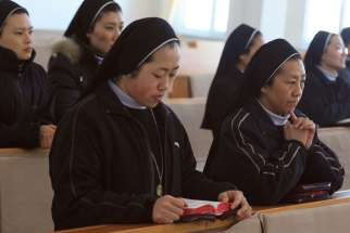 Members of the Sisters of the Sacred Heart pray in their motherhouse chapel in Fushun, China, in this 2007 file photo. Pope Francis asked Catholics worldwide to show solidarity through their prayers for Catholics in China and for persecuted Christians over the Pentecost weekend.