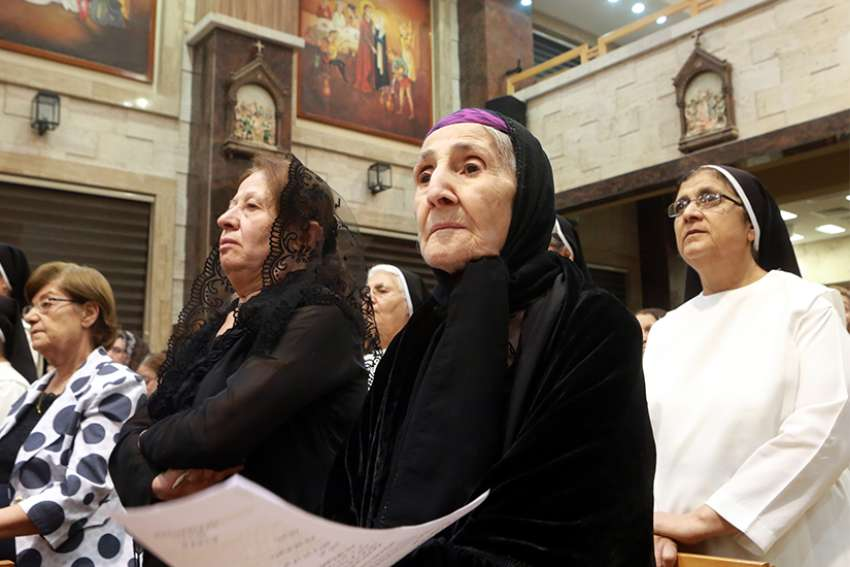 Iraqi Christians pray at the Church of our Lady of Perpetual Help during an interfaith service in Ainkawa in 2016. Iraqi Christians of various communities gathered with their church leaders to offer a prayer of support to Iraqi forces in the fight against the Islamic State.