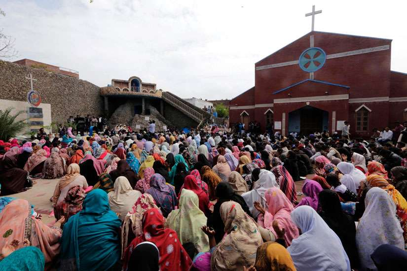 Pakistani Christians gather at a church March 16 to protest two suicide attacks on churches in Lahore. The latest round of attack happened June 4 when two gunmen open fired at St. Joseph Church