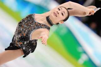 Yuna Kim performs in the Ladies' Figure Skating Short Program in Vancouver, during the 2010 Winter Olympics on Feb. 23, 2010.