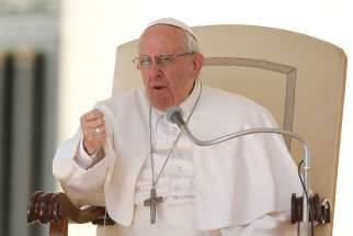 Pope Francis gestures as he leads his general audience in St. Peter's Square at the Vatican March 29.