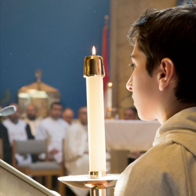 An altar server attends to the Divine Liturgy celebrated by Maronite Patriarch Bechara Rai at St. Sharbel Maronite Church in Warren, Mich., May 13. The leader of the Maronite Catholic Church, whose home base is Lebanon, was in the Detroit area for a past oral visit. Michigan has an estimated 100,000 Maronites and has one of the largest Arab populations in the States.