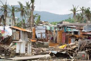 This photo taken Feb. 10, 2014 from the home of Emmanuel and Maria Rosevilla Margate shows homes left in ruins in Tacloban, Philippines. The family huddled together in their block home Nov. 8, 2013, as Typhoon Haiyan made shambles of many homes in their community.