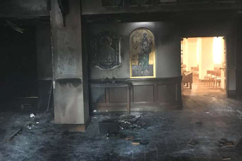 Queen of Peace Catholic Church in Ocala, Fla., is seen July 13, 2020, after it was set ablaze by a suspect who drove his van through the front doors two days earlier.